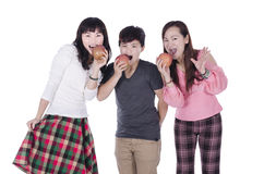 Pertty girls eating apples. Over white background Royalty Free Stock Photo