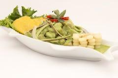 Peru Dish: Cebiche (ceviche) en Crema Andina. Basil, coriander, fresh fish, lemon juice, onion, sweet potatoe, camote stock photo
