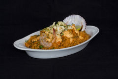 Peru Dish: Rice with Seafood (Arroz con Mariscos), served with a glass of chicha. Stock Images