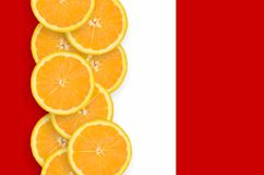Peru flag and citrus fruit slices vertical row. Peru flag and vertical row of orange citrus fruit slices. Concept of growing as well as import and export of stock illustration