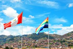 Peru flag and Cusco flag on the city roofs and blue sky background. Peru, Latin America. Horizontal stock photos