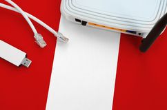Free Peru Flag Depicted On Table With Internet Rj45 Cable, Wireless Usb Wifi Adapter And Router. Internet Connection Concept Royalty Free Stock Image - 165868886