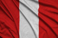 Peru flag is depicted on a sports cloth fabric with many folds. Sport team banner. Peru flag is depicted on a sports cloth fabric with many folds. Sport team stock photo