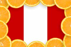 Peru flag in fresh citrus fruit slices frame. Peru flag in frame of orange citrus fruit slices. Concept of growing as well as import and export of citrus fruits royalty free stock photos