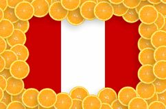 Peru flag in fresh citrus fruit slices frame. Peru flag in frame of orange citrus fruit slices. Concept of growing as well as import and export of citrus fruits royalty free stock image