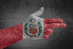 Peru flag painted on male hand like a gun royalty free stock image