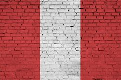 Peru flag is painted onto an old brick wall royalty free illustration