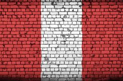 Peru flag is painted onto an old brick wall stock images