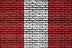Peru flag is painted onto an old brick wall stock illustration