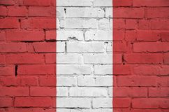 Peru flag is painted onto an old brick wall stock photo