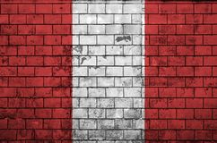 Peru flag is painted onto an old brick wall stock photos