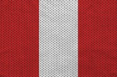 Peru flag printed on a polyester nylon sportswear mesh fabric wi. Th some folds royalty free stock photo