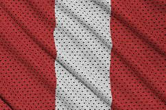 Peru flag printed on a polyester nylon sportswear mesh fabric wi. Th some folds stock photos