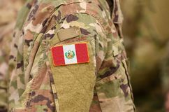 Peru flag on soldiers arm. Peru troops collage.  royalty free stock image