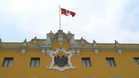 Peru flag waving on the yellow building stock video