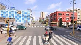 Pedestrians cross the road to Lima Peru