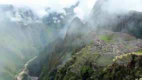 Peru Machu Picchu ancient inca ruin site Panorama with morning clouds. stock footage