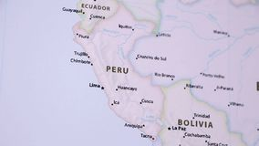 Peru on a Map with Defocus. Peru on a political map of the world. Video defocuses showing and hiding the map stock video footage