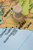 Peru marked on a map. Close up of a world map with the word peru in focus royalty free stock image