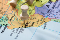 Peru marked on a map. Close up of a world map with the word peru in focus stock image