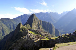Peru Panorama of Machu Pichu with Wayna Peak. Panorama of Machu Pichu with Huayna Picchu in Peru, rainforest jungle and mountains with blue sky in the background stock photos