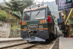 Peru Rail train arriving at Machu Picchu Station. Aguas Calientes, Peru - Sep 13, 2018: Peru Rail train arriving at Machu Picchu Station in Aguas Calientes stock photography