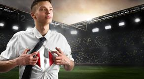 Peru soccer or football supporter showing flag. Under his business shirt on stadium stock images