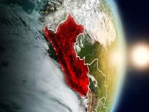 Peru during sunrise. Highlighted in red on planet Earth with visible country borders. 3D illustration. Elements of this image furnished by NASA royalty free stock image