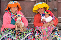 Peru1. Cusco, Peru - May 31: Unidentified Peruvian   women with child on the streets of Cusco displaying one type of traditional dress and headcover, on May 31 Stock Photos