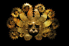 Peruvian ancient mask made out of gold and zaphire Stock Photos