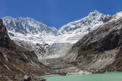 Peruvian Andes, and Ocshapalpa and Ranrapalca peak. Llaca lagoon (4474 m) in the peruvian Andes and Ocshapalpa peak (5888 m) and Ranrapalca peak (6162 m), Peru royalty free stock images