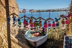 Peruvian boat on reed island on Titicaca lake near Puno, Peru Royalty Free Stock Photography