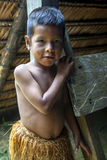 A Peruvian boy near Iquitos in Peru. A  Peruvian boy dressed in tradition Indian costume near Iquitos on the Amazon River in Peru Stock Photo