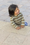 Peruvian boy smiling. CUZCO, PERU - JUNE 1, 2013: Peruvian boy smiles while playing around the Plaza de Armas during the week of Corpus Christi celebrations Royalty Free Stock Image