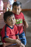 Peruvian boys in Indiana in Peru. Two Peruvian boys sit in the classroom at the school in Indiana on the Amazon River in Peru Royalty Free Stock Photo