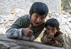 Peruvian boys at the Maras salt evaporation ponds in Peru. Stock Image