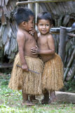 Peruvian boys near Iquitos in Peru. Peruvian boys dressed in tradition Indian grass skirts near Iquitos on the Amazon River in Peru Stock Image