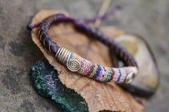 Bracelet on natural background. Peruvian bracelet on natural background stock photo