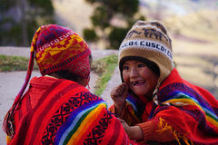 Peruvian children playing. Young Peruvian children playing in traditional Quechua clothing Stock Photo
