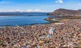 Peruvian city Puno and lake Titicaca panorama Peru. Peruvian city Puno and lake Titicaca panorama, Peru stock image