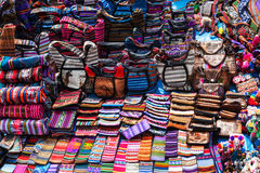 Peruvian clothes and bags. On the market stock image