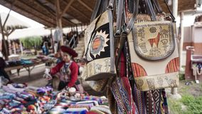 Peruvian clothes and bags on the market. The peruvian clothes and bags on the market stock image