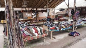 Peruvian clothes and bags on the market. The peruvian clothes and bags on the market stock photography