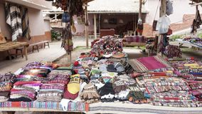 Peruvian clothes and bags on the market. The peruvian clothes and bags on the market stock images