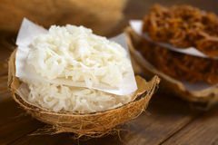 Peruvian Cocadas. A traditional coconut dessert sold usually on the streets, made of grated coconut and white or brown sugar, which gives the different stock photo