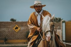 Peruvian cowboy riding a horse stock photography