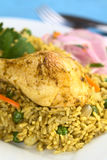 Peruvian Dish Called Arroz con Pollo. (Rice with Chicken), which is made of rice, chicken parts, peas, corn, aji (hot pepper), cilantro and served with Salsa Royalty Free Stock Images