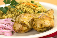 Peruvian Dish Called Arroz con Pollo. (Rice with Chicken), which is made of rice, peas, corn, aji (hot pepper), cilantro served with chicken and Salsa Criolla ( Royalty Free Stock Images