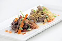 Peruvian dish called Lomo Saltado made of tomato, beef meat and onions mixed with French fries. royalty free stock photos
