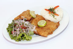 Peruvian Dish: Fried Fish with salad, lemon and rice. Stock Images
